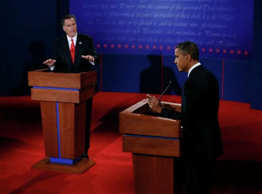 President Barack Obama and Republican presidential nominee Mitt Romney participate in the first presidential debate at the University of Denver, Wednesday, Oct. 3, 2012, in Denver. (AP Photo/Pool, Rick Wilking) Photo: Rick Wilking / Reuters Pool