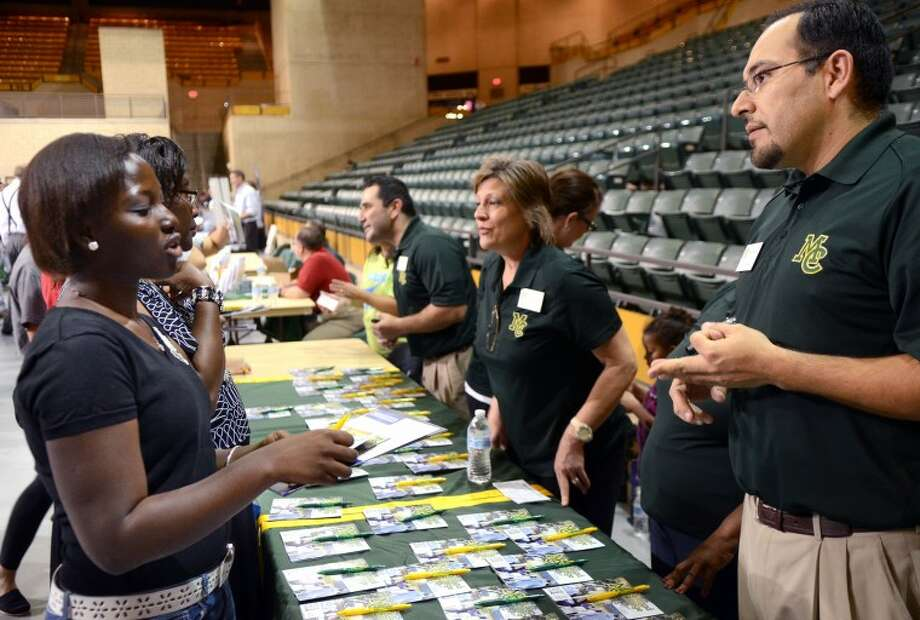 Abigail Kyei, a Junior at Lee High, speaks with Jeremy Martinez, Director of Admissions for Midland College, during the College Forum Thursday at the Chaparrel Center. The free event gave students and families the opportunity to meet representatives from various area colleges. James Durbin/Reporter-Telegram Photo: JAMES DURBIN
