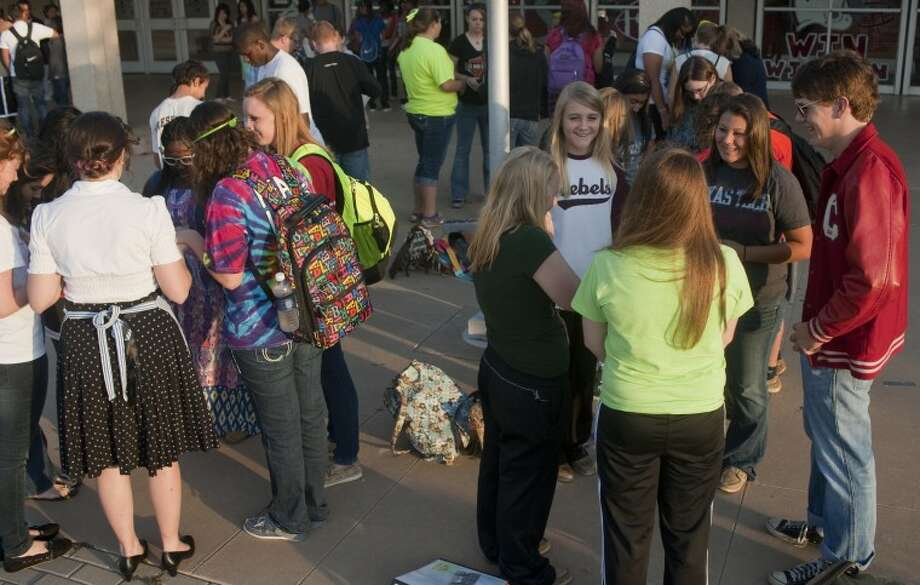 Students break into smaller prayer groups outside Lee High School Wednesday morning for the annual student led prayers for See You At the Pole. Tim Fischer\Reporter-Telegram Photo: Tim Fischer