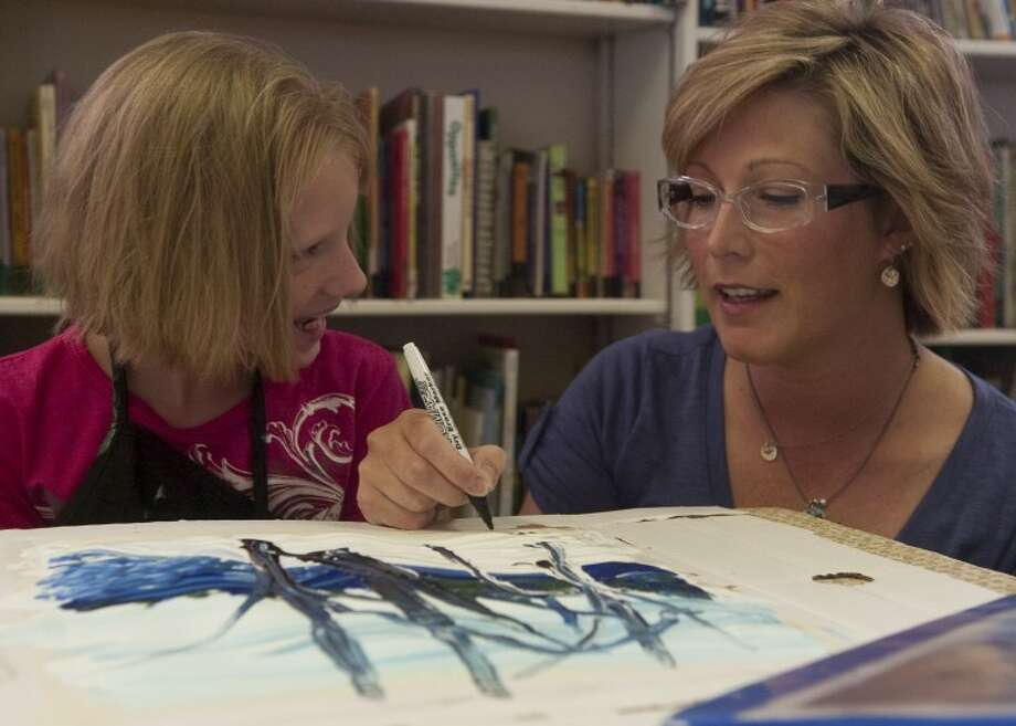 Megan Miller, Mneme Therapist, works with Mercedes Hounshell, 10, Thursday at Bynum School. Photo by Tim Fischer/Midland Reporter-Telegram Photo: Tim Fischer