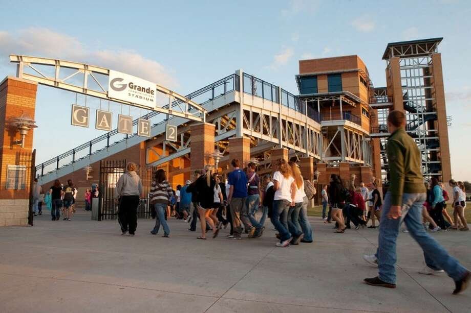 Hundreds of area students and athletes walk into the gates of Grande Communication Stadium  for the 2010 Fields of Faith event. Photo: MRT File Photo