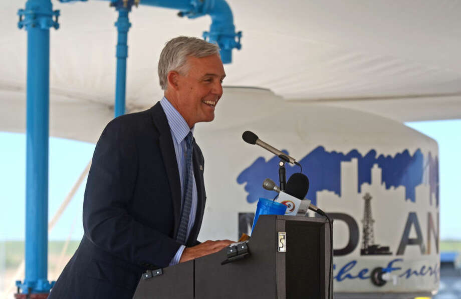 Mayor Wes Perry speaks during the T-Bar ribbon cutting ceremony Friday at the elevated storage tank near 191 and 1788. James Durbin/Reporter-Telegram Photo: JAMES DURBIN