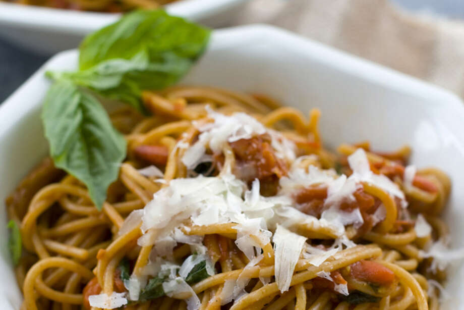 This Aug. 15, 2011 photo shows pasta pomodoro in Concord, N.H. Rocco DiSpirito's pasta pomodoro recipe uses any variety of tomato so long as they are very ripe. (AP Photo/Matthew Mead) Photo: Matthew Mead / FR170582 AP