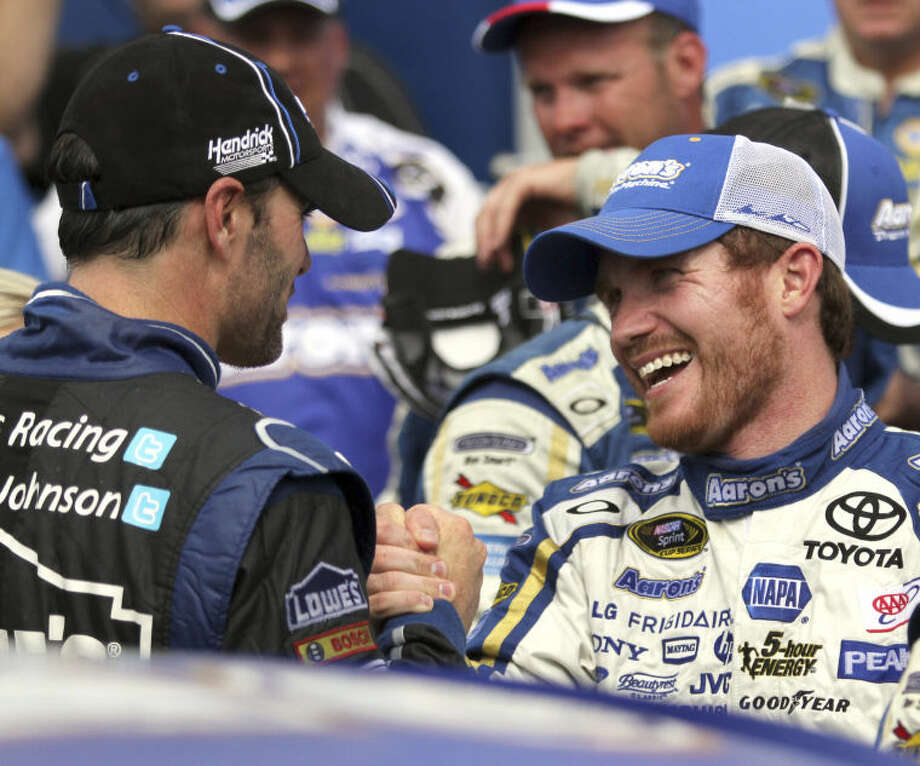 Brian Vickers, right, is congratulated by Jimmie Johnson in Victory Lane after winning the NASCAR Sprint Cup Series auto race, Sunday, July 14, 2013, at New Hampshire Motor Speedway in Loudon, N.H. (AP Photo/Mary Schwalm) Photo: Mary Schwalm