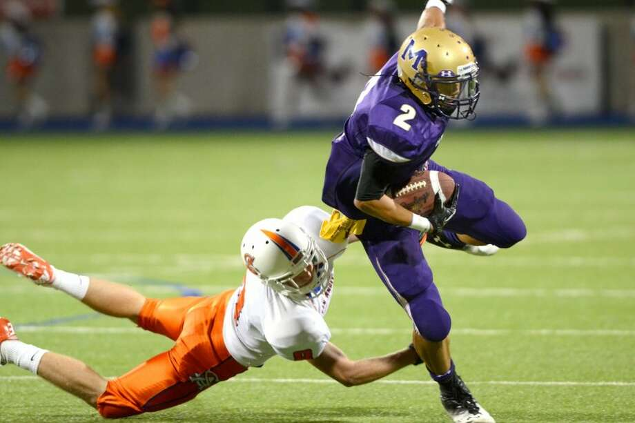 Midland High wide receiver Phillip Fuentes dodges a tackle from a San Angelo Central defender Friday at Grande Communications Stadium. James Durbin/Reporter-Telegram Photo: JAMES DURBIN