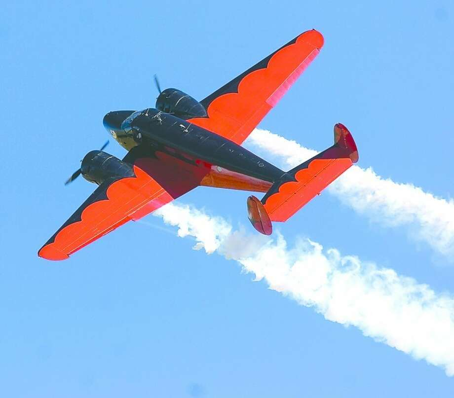 Matt Younkin pilots his Beech 18 through the skies during an AirSho preview party for people with special needs and area sixth graders. Photo by Tim Fischer/Midland Reporter-Telegram Photo: Tim Fischer