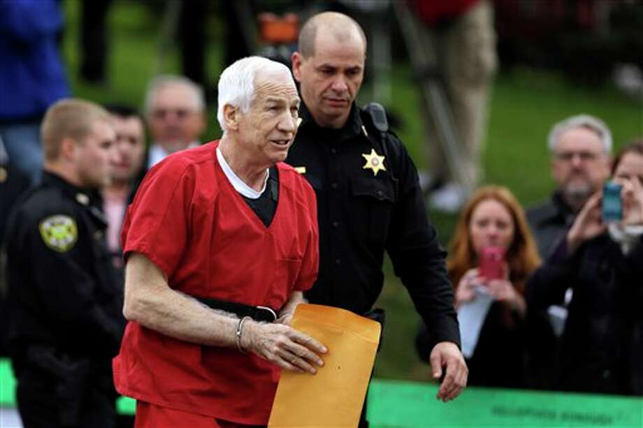 Former Penn State University assistant football coach Jerry Sandusky arrives at the Centre County Courthouse for a sentencing hearing Tuesday, Oct. 9, 2012, in Bellefonte, Pa. Sandusky was convicted of sexually abusing 10 boys in a scandal that rocked the university and brought down Hall of Fame coach Joe Paterno. (AP Photo/Matt Rourke) Photo: Matt Rourke / AP2012