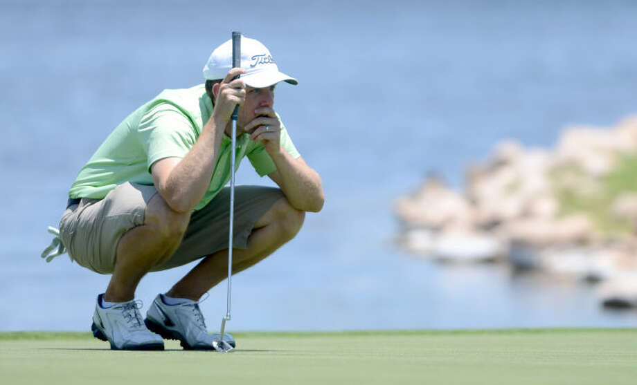 Zach Atkinson studies the putting green during day 2 of the Green Tree Jamboree Saturday at Green Tree Country Club. James Durbin/Reporter-Telegram Photo: JAMES DURBIN