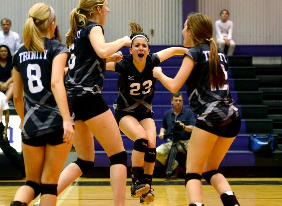 In this October 2012 file photo, the Trinity School volleyball team celebrates after scoring against Midland Classical Academy. James Durbin/Reporter-Telegram Photo: JAMES DURBIN