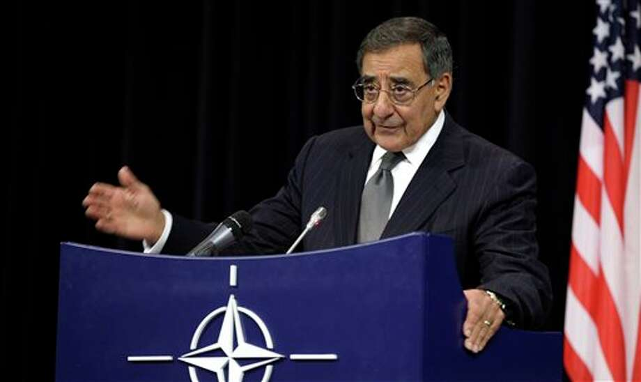 United States Secretary of Defense Leon Panetta gestures while speaking during a media conference after a meeting of NATO Defense Ministers at NATO headquarters in Brussels on Wednesday, Oct. 10, 2012. NATO defense ministers gathered in Belgium Wednesday to begin deliberating the next phase of the Afghanistan war and to hear how military commanders plan to tamp down the insider attacks that have killed or injured 130 allied forces. (AP Photo/Virginia Mayo) Photo: Virginia Mayo / AP