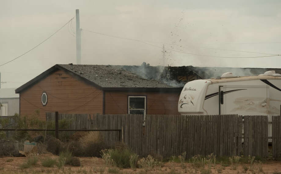 Midland fire units respond to a house fire in the 9000 block of W CR 50 Monday afternoon. Tim Fischer\Reporter-Telegram Photo: Tim Fischer