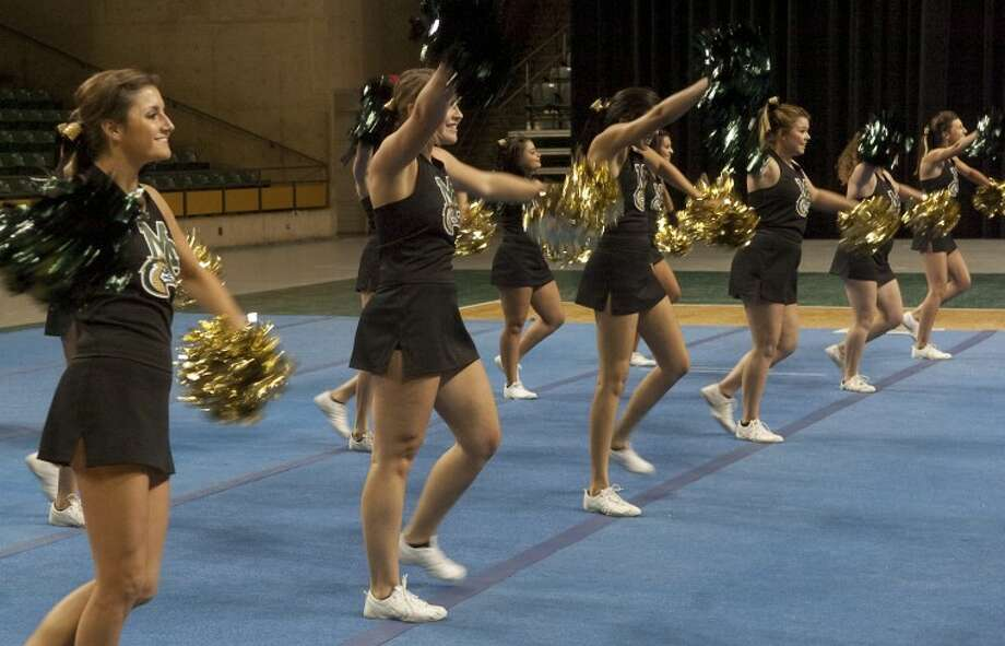 Midland College cheerleaders perform Thursday to help welcome and open the new student orientation at the Chaparral Center. Photo: Tim Fischer/Reporter-Telegram