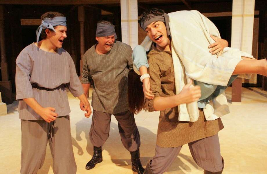 """The pirates, from left, (Max Stanley) (George Melonakis) and (Alexander Mancha) celebrate after kidnapping Marina (Vanessa Hernandez), Friday during a scene from """"Pericles"""" at the Globe Theatre. Cindeka Nealy/Reporter-Telegram Photo: Cindeka Nealy"""