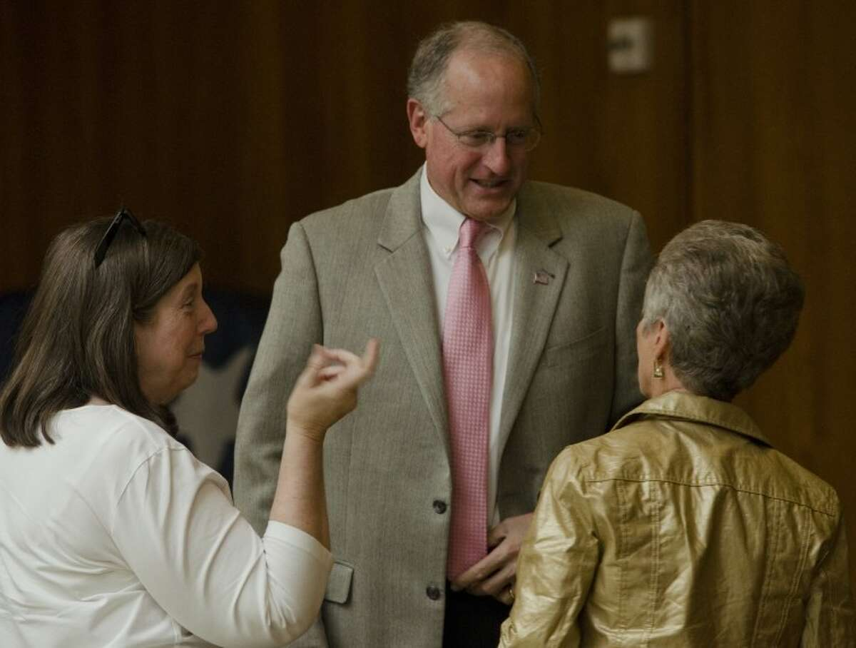 Mike Conaway speaks with Sandra Driscoll and Evelyn Davis Wednesday before addressing the Midland County Republican Women's luncheon. Tim Fischer\Reporter-Telegram