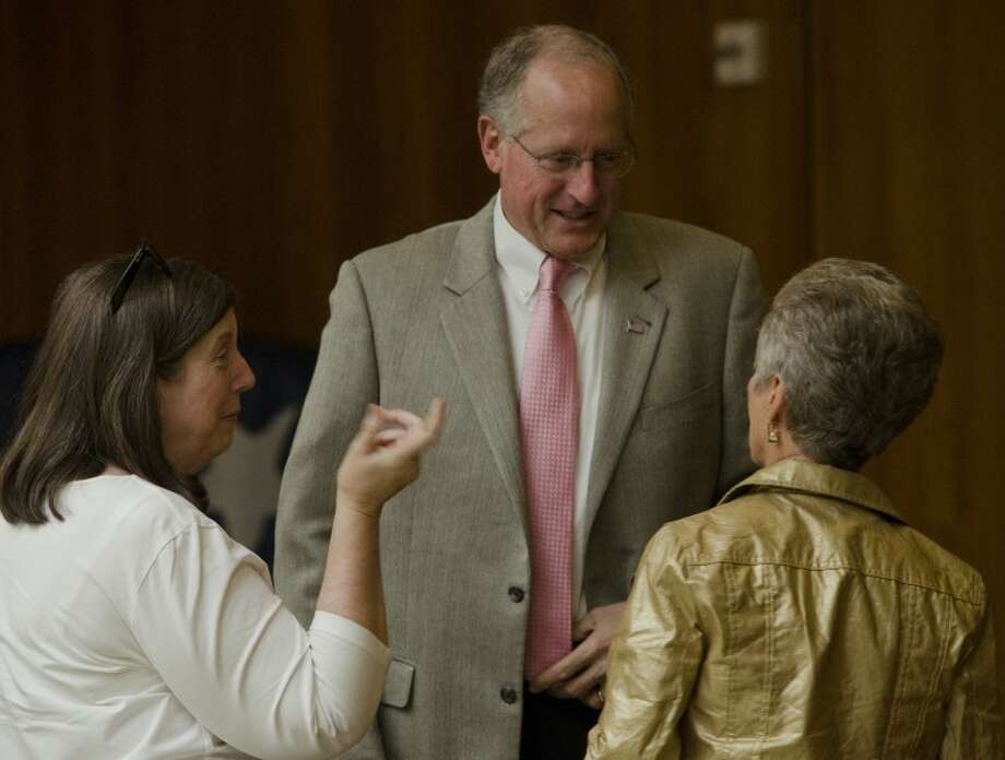 Mike Conaway speaks with Sandra Driscoll and Evelyn Davis Wednesday before addressing the Midland County Republican Women's luncheon. Tim Fischer\Reporter-Telegram Photo: Tim Fischer