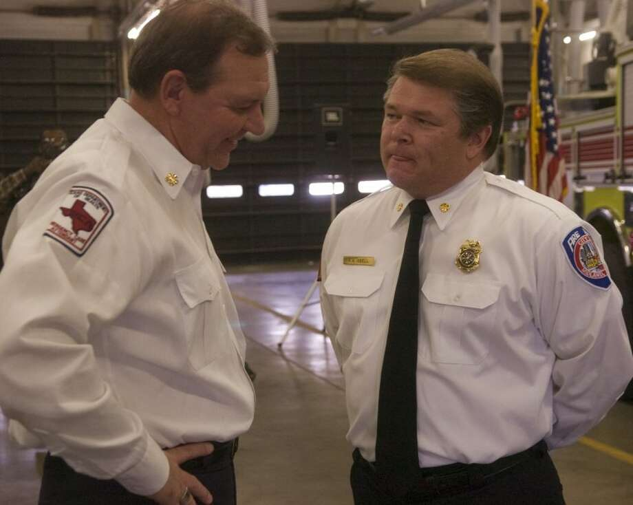 (Fire Chief) Odessa Fire Chief Roger Boyd, left, talks with Midland's newest Fire Chief Robert Isbell Tuesday afternoon following the press conference officially announcing Isbell as the new chief. Photo by Tim Fischer/Midland Reporter-Telegram Photo: Tim Fischer