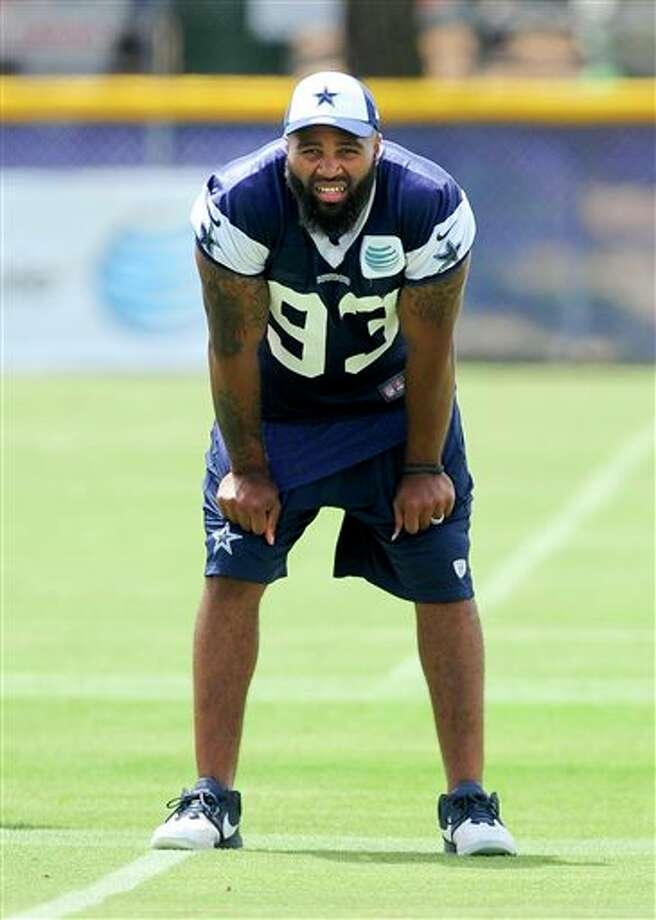 Dallas Cowboys linebacker Anthony Spencer looks on from the sidelines during the Cowboys training camp, Monday, July 22, 2013, in Oxnard, Calif. (AP Photo/Gus Ruelas) Photo: Gus Ruelas / FR157633 AP