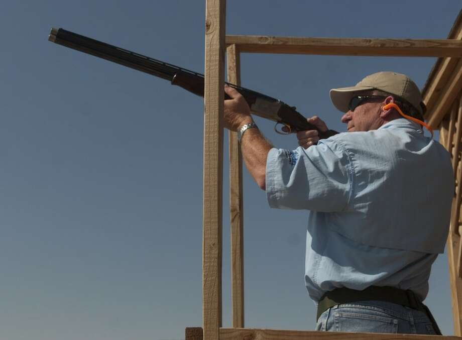 T Bob Hauger with Complete Production Services tracks his shot Friday at the 10th annual XTO Energy and Concho Resources Bustin' Clay for United Way pigeon shoot. Photo: Tim Fischer/Midland Reporter-Telegram