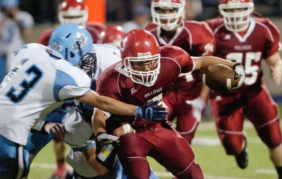 Coahoma running back Sheigh Cravens (5) gets wrapped up by the Greenwood defense as he attempts to gain the extra yardage Thursday during their game at Grande Communication Stadium. Photo: Cindeka Nealy/Reporter-Telegram