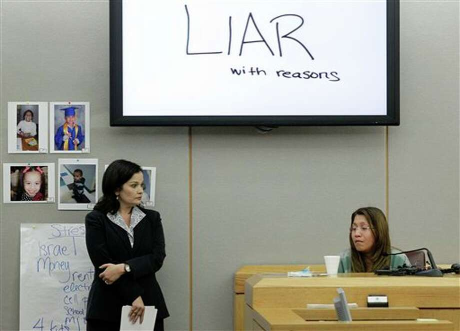 FILE - In a Thursday, Oct. 11, 2012 file photo, the words shown on a overhead display written by prosecutor Eren Price, left, are shown in court as an emotional Elizabeth Escalona, 23, responds to a line of questioning during the sentencing phase of her trial Thursday, Oct. 11, 2012, in Dallas. Escalona was sentenced Friday, Oct. 12, 2012 to 99 years in prison for beating her toddler and gluing the child's hands to a wall. (AP Photo/Tony Gutierrez, File) Photo: Tony Gutierrez / AP