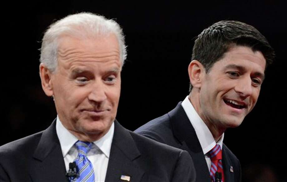 Vice President Joe Biden and Republican vice presidential nominee Rep. Paul Ryan of Wisconsin gesture after the vice presidential debate at Centre College, Thursday, Oct. 11, 2012, in Danville, Ky. (AP Photo/Pool-Michael Reynolds) Photo: Michael Reynolds / AP2012