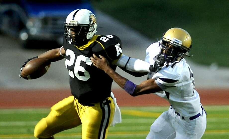 Michael Norris / Amarillo Globe-News Ashton Tillman (26), Amarillo, tries to get a way from defender Brandon Williams (17), Midland, during the Midland High Bulldogs and Amarillo High Sandies game Friday, August 26, 2011 at Dick Bivins Stadium.. Photo: Michael Norris / Amarillo Globe-