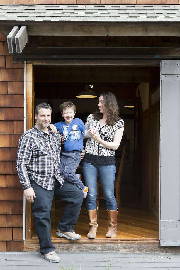 Jared Nelson, his wife Sarah Kobrinsky, and their 5-year-old son Jake, live in this 1960's, cabin-like house in Point Richmond, CA which was photographed on May 9, 2016.  The couple moved about a year ago, after being priced out of their place in Emeryville, CA. Photo: Vivian Johnson, Special To The Chronicle