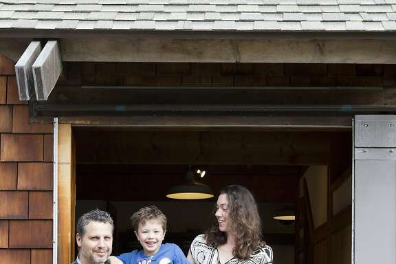 Jared Nelson, his wife Sarah Kobrinsky, and their 5-year-old son Jake, live in this 1960's, cabin-like house in Point Richmond, CA which was photographed on May 9, 2016.  The couple moved about a year ago, after being priced out of their place in Emeryville, CA.