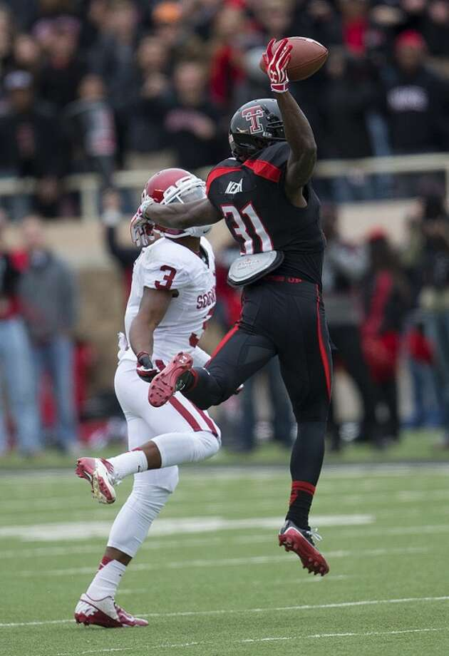 Texas Tech defender Eugene Nebouh (31) knocks a pass away from Oklahoma receiver Sterling Shephard (3) in Big XII action Saturday at Jones AT&T stadium in Lubbock. The Sooners went on to defeat the former Odessa Permian standout 41-20. Photo: Wade H Clay