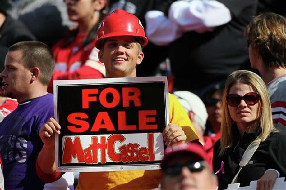 A Kansas City Chiefs fan hold a sign after Chiefs quarterback Matt Cassel was injured in the 4th quarter of an NFL football game against the Baltimore Ravens, Sunday, Oct. 7, 2012, in Kansas City, MO. (AP Photo/Colin E Braley) Photo: Colin E. Braley / AP2012