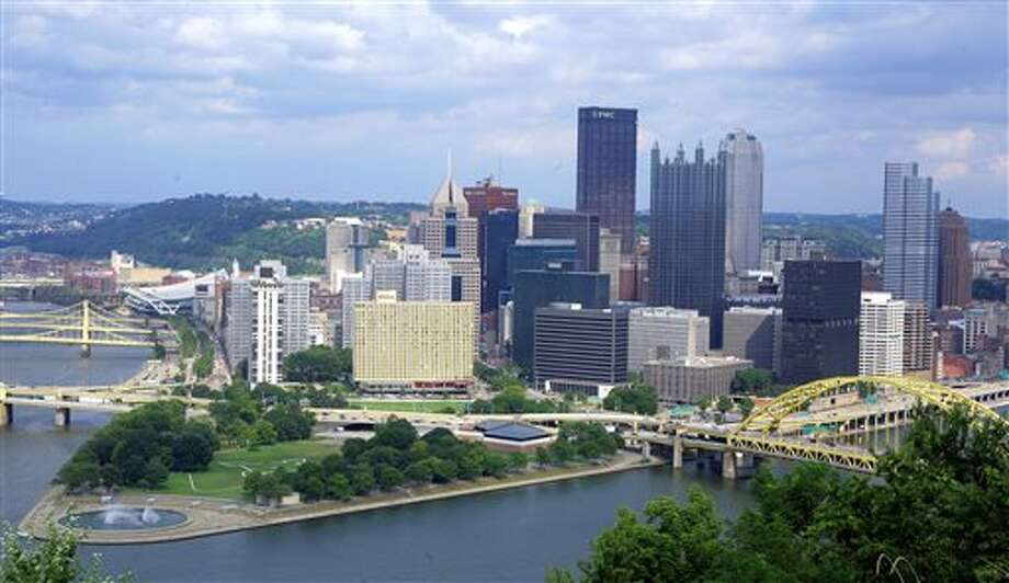 In this Aug. 18, 2009, aerial photo is downtown Pittsburgh located at the confluence of the Allegheny, Monongahela and Ohio rivers on the north side of Pittsburgh. Like Detroit, Pittsburgh was a community defined by its dependence on a single industry. But as steelmaking crumbled under pressure from foreign imports and the decline of the U.S. auto industry, the city's population dropped by more than 40 percent between 1970 and 2006, according to a 2013 report from the U.S. Federal Reserve Bank of Cleveland. But during those years, Pittsburgh also forged a new identity around health care and technology. Detroit's bankruptcy can't be blamed solely on the city's reliance on one industry that itself buckled. Some point to the city's political leadership and its reluctance over the years to make tough decisions. (AP Photo/Gene J. Puskar) Photo: Gene J. Puskar / AP