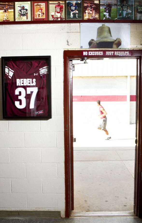 A jersey belonging to Jacob Power hangs in the Lee High football field house in memory of Power, who died in a car accident June 3, 2012. James Durbin/Reporter-Telegram Photo: JAMES DURBIN