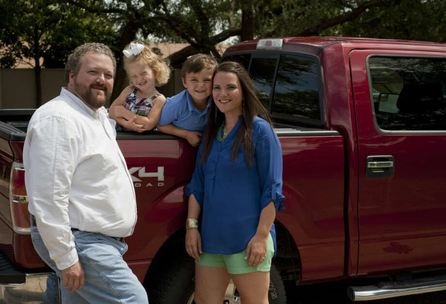 Clint Williamson drives to Eunice, NM daily for his job at the uranium enrichment plant, in his red Ford truck scene with his family, Kate and children Hunter and Eloise. Tim Fischer\Reporter-Telegram Photo: Tim Fischer