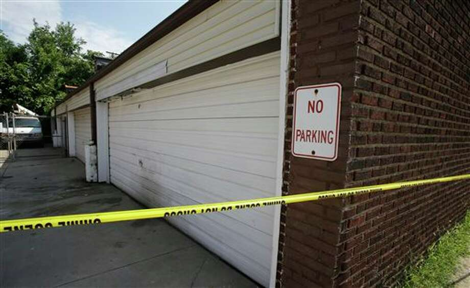 A garage is shown Sunday, July 21, 2013, where a body was found recently in East Cleveland, Ohio. The bodies, believed to be female, were found about 100 to 200 yards (90 to 180 meters) apart, and a 35-year-old man was arrested and is a suspect in all three deaths, though he has not yet been charged, East Cleveland Mayor Gary Norton said Saturday. (AP Photo/Tony Dejak) Photo: Tony Dejak / AP