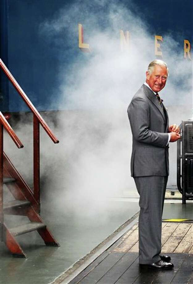 Britain's Prince Charles arrives on the Bittern steam locomotive as he visits the National Railway Museum in York, Britain, Monday, July 22, 2013. Prince William's wife, Kate, is in the early stages of labor in a private wing of a central London hospital, palace officials said Monday. It is a historic moment for the British monarchy — the couple's first child will become third in line for the British throne, after Prince Charles and William, and should eventually become king or queen. (AP Photo/PA, Lynne Cameron) UNITED KINGDOM OUT, NO SALES, NO ARCHIVE Photo: Lynne Cameron / PA