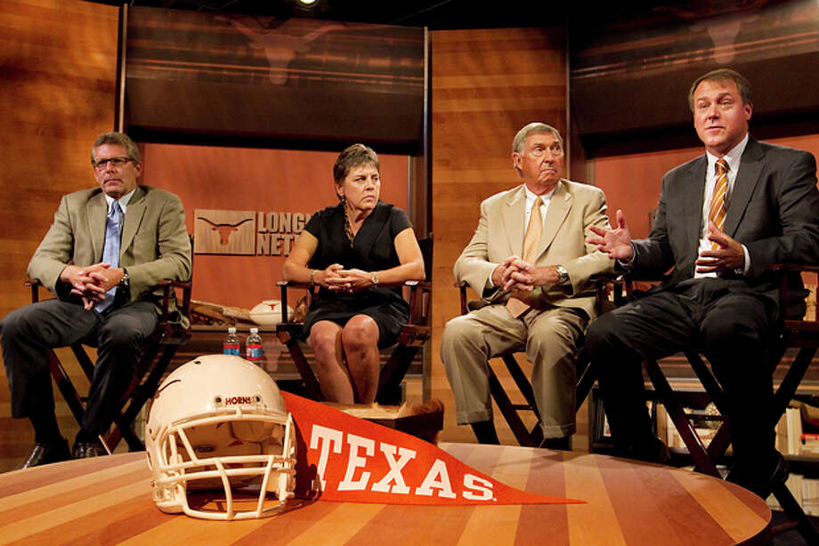 The new Longhorn Network vice president of programming Dave Brown, left, Chris Plonsky, second left, Texas women's athletic director; Deloss Dodds, second right, Texas athletic director, and Burke Magnus, senior vice president for college sports, look on during a news conference inside the new Longhorn Network studios Thursday, Aug. 18, 2011 in Austin, Texas. (AP Photo/Austin American-Statesman, Ralph Barrera) Photo: Ralph Barrera / Austin American-Statesman