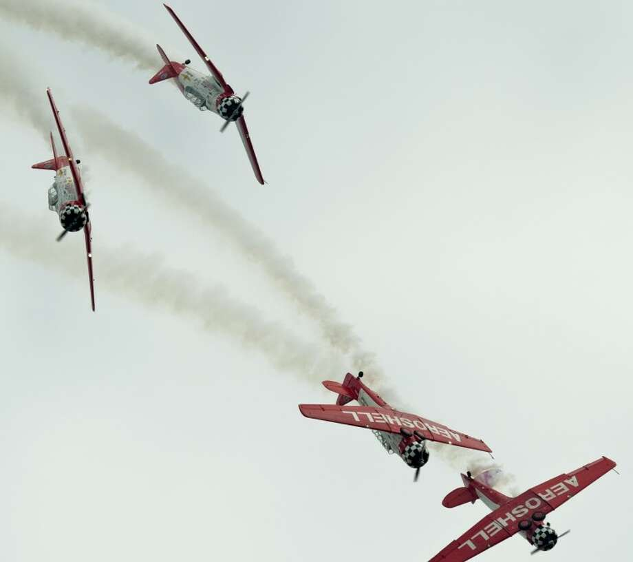 Aeroshell flight team perform maneuvers Friday during the Junior Aces AirSho performance at the CAF. Tim Fischer\Reporter-Telegram Photo: Tim Fischer