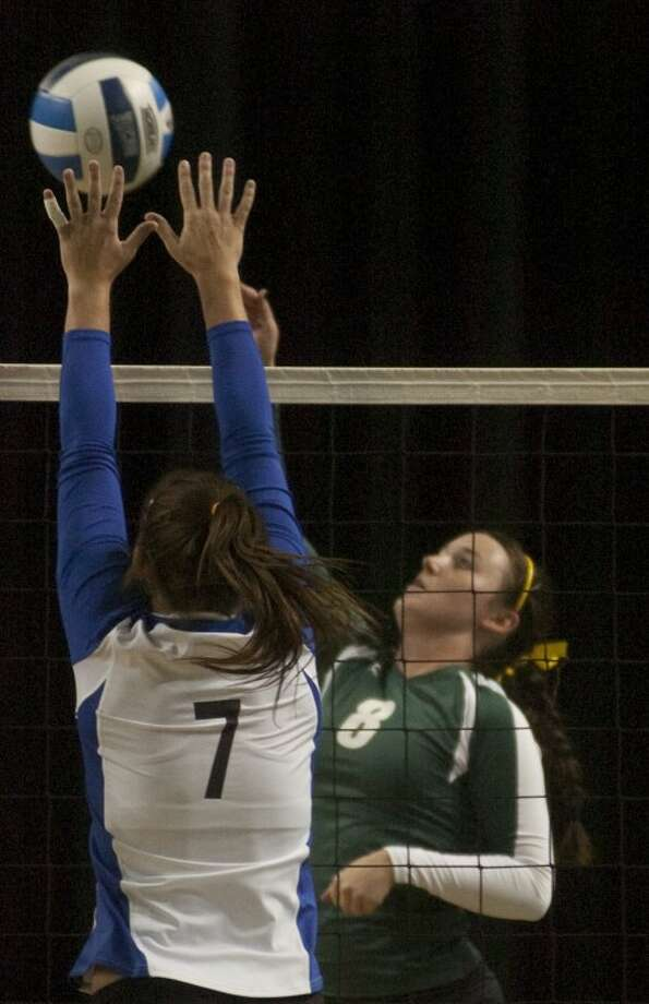 Blinn College's Kelsey Schwartz goes up to block a hit by Midland College's Keli Key-Wilson Saturday at the Chaparral Center. Photo by Tim Fischer/Midland Reporter-Telegram Photo: Tim Fischer