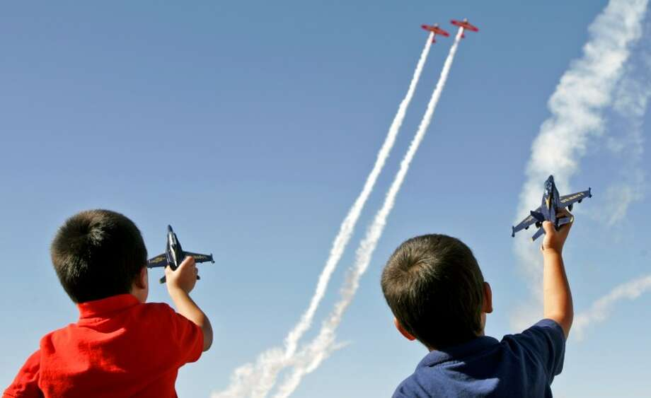 """I like this picture because it captures what I remember feeling as a child at an airshow. This image also won 2nd Place in the Feature category of the National Press Photographers Association October monthly clip contest."" - James DurbinFrom left, Zaniel Payen, age 4, and Emanuel Duran, age 5, watch a performance by the AeroShell Aerobatic Team during AirSho 2012 Saturday at Midland International Airport. James Durbin/Reporter-Telegram Photo: JAMES DURBIN"