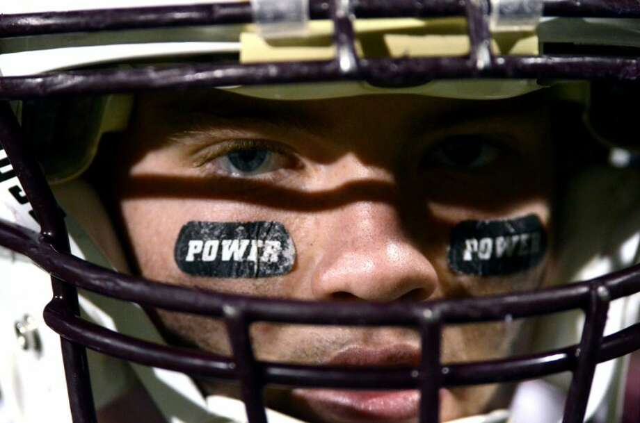Members of the Midland Lee football team wore strips inscribed 'Power' in memory of Jacob Power, a Lee football player who was killed in a car crash June 3, 2012. James Durbin/Reporter-Telegram Photo: JAMES DURBIN