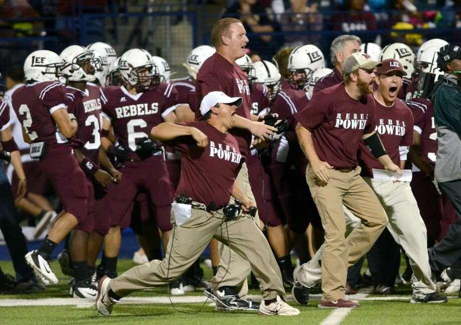 Coaches react after a run by Midland Lee against Abilene High Friday at Grande Stadium. James Durbin/Reporter-Telegram Photo: JAMES DURBIN