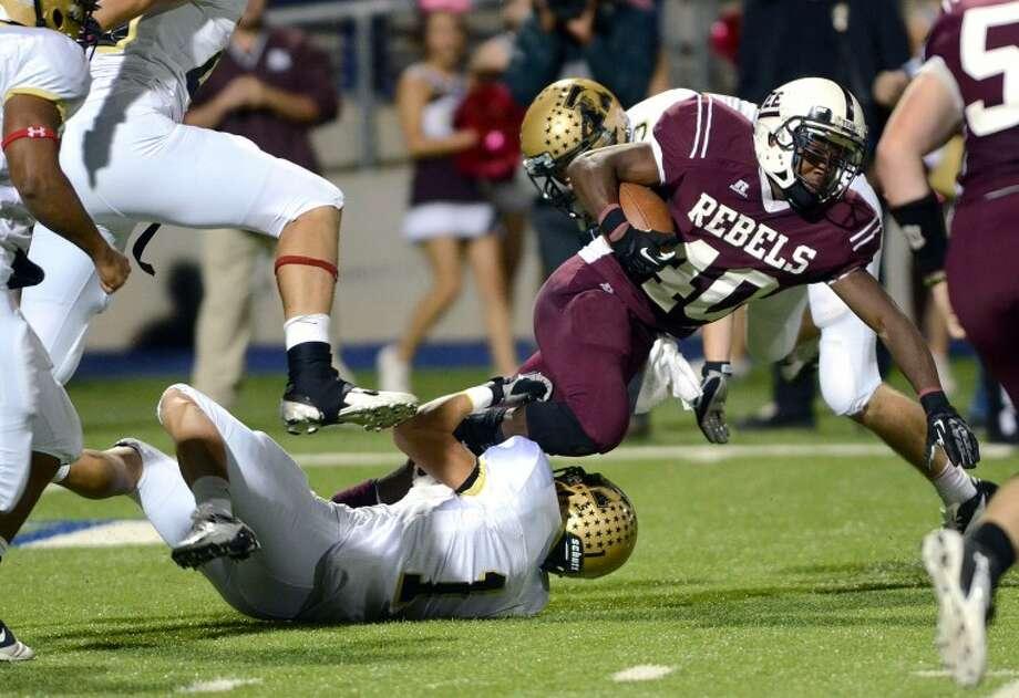 Midland Lee running back Jason McAfee is wrapped up by the Abilene High defense Friday at Grande Stadium. James Durbin/Reporter-Telegram Photo: JAMES DURBIN
