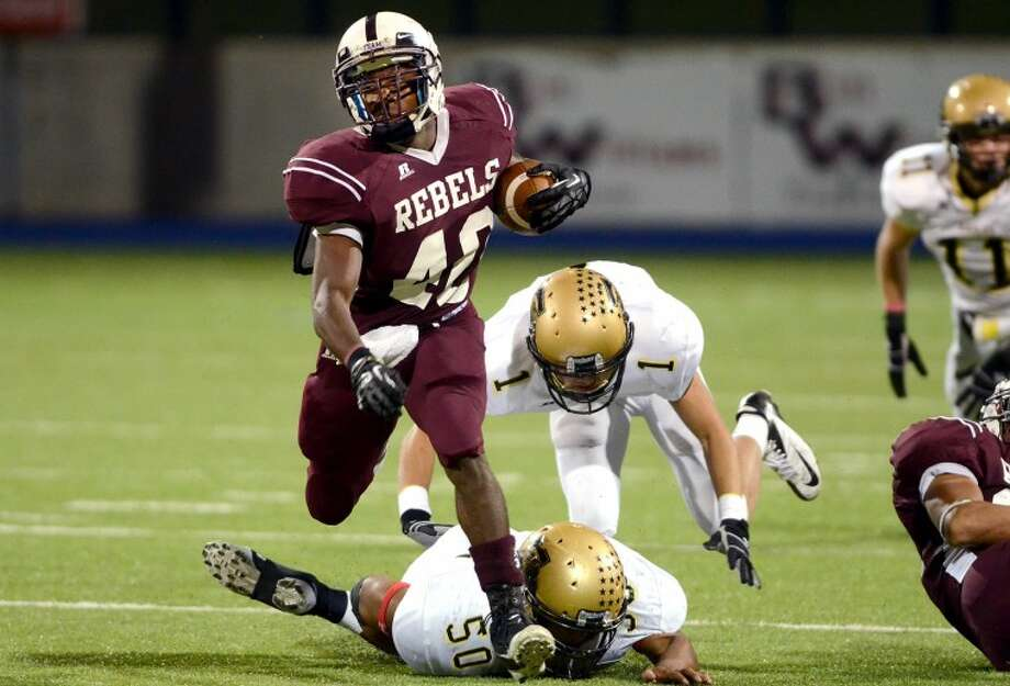 Midland Lee running back Jason McAfee outruns the Abilene High defense Friday at Grande Stadium. James Durbin/Reporter-Telegram Photo: JAMES DURBIN