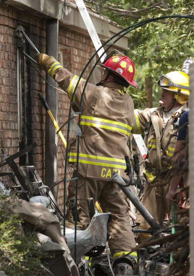 Midland fire personnel respond to a house fire Tuesday at 4402 Norwood. Tim Fischer\Reporter-Telegram Photo: Tim Fischer