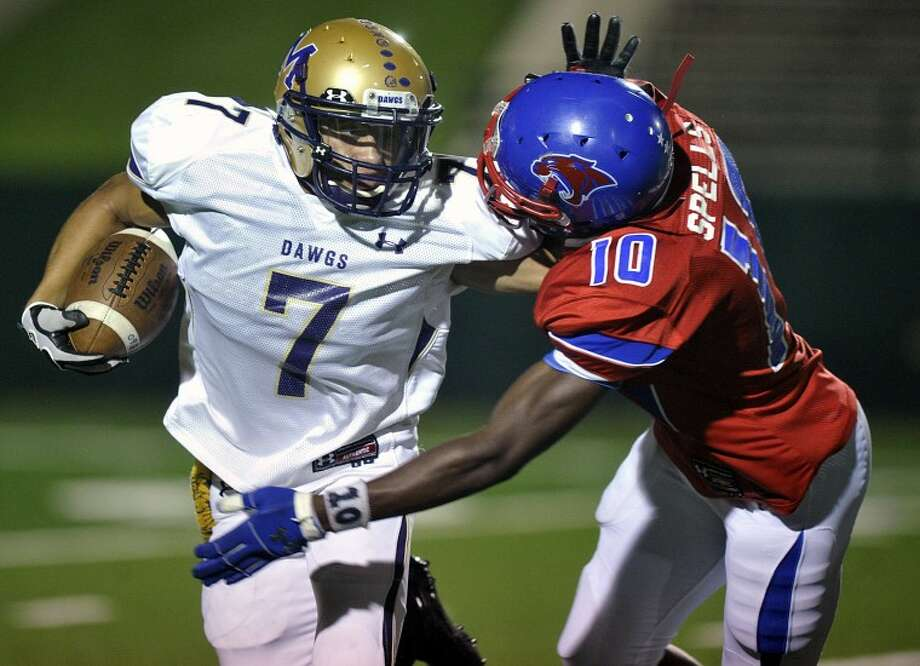 Eric J. Shelton/Reporter-News Xzavier Martinez (7) tries to get around Cooper linebacker Trey Spells (10) during their game at Shotwell Stadium in Abilene, Texas Friday night, October 12, 2012.