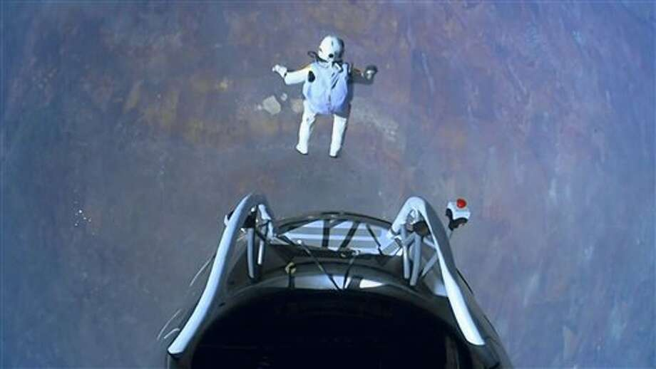 This image made from video, provided by Red Bull Stratos shows pilot Felix Baumgartner of Austria as he jumps out of the capsule during the final manned flight for Red Bull Stratos on Sunday, Oct. 14, 2012. In a giant leap from more than 24 miles up, Baumgartner shattered the sound barrier Sunday while making the highest jump ever — a tumbling, death-defying plunge from a balloon to a safe landing in the New Mexico desert. (AP Photo/Red Bull Stratos) Photo: Uncredited / AP2012