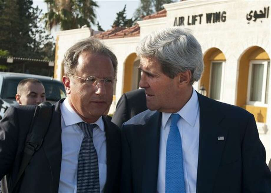 Secretary of State John Kerry, right, chats with Deputy Special Envoy for Middle East Peace Frank Lowenstein while walking to board a flight on July 19, 2013 in Amman, Jordan. (AP Photo/Mandel Ngan, Pool) Photo: MANDEL NGAN / POOL