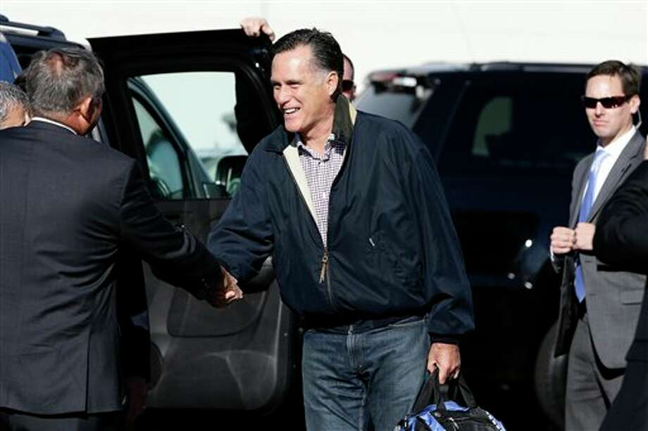 Republican presidential candidate, former Massachusetts Gov. Mitt Romney is greeted as he steps off his campaign plane in Ronkonkoma, N.Y., Tuesday, Oct. 16, 2012, as he arrived for his debate against President Barack Obama. (AP Photo/Charles Dharapak) Photo: Charles Dharapak / AP