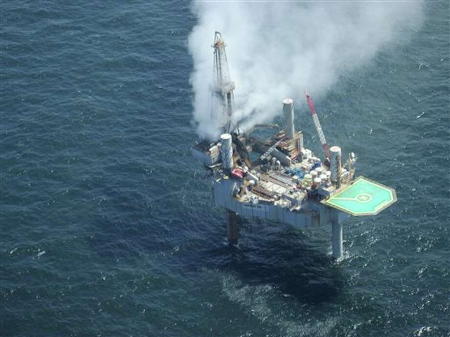 This photo released by the Bureau of Safety and Environmental Enforcement shows natural gas spewing from the Hercules 265 drilling rig in the Gulf of Mexico off the coast of Louisiana, Tuesday, July 23, 2013. No injuries were reported in the midmorning blowout and there was no fire as of Tuesday evening at the site, about 55 miles off the Louisiana coast in the Gulf of Mexico. (AP Photo/Bureau of Safety and Environmental Enforcement) Photo: Uncredited / AP2013