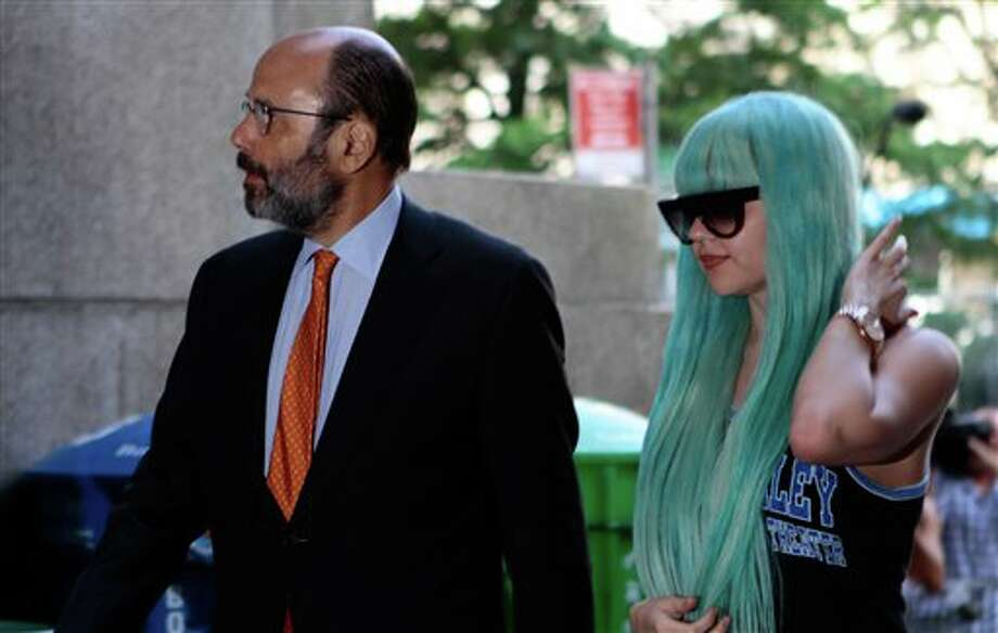 FILE - In a Tuesday, July 9, 2013 file photo, Amanda Bynes, accompanied by attorney Gerald Shargel, arrives for a court appearance in New York on allegations that she chucked a marijuana bong out the window of her 36th-floor Manhattan apartment. Bynes has been hospitalized for a mental health evaluation after deputies said she started a small fire in the driveway of a home in Southern California. Ventura County sheriff's Capt. Don Aguilar says deputies responding to a call Monday night, July 22, 2013 found Bynes standing next to the flames in the city of Thousand Oaks, Calif. The deputies determined she met the criteria for a mental health hold and took her into custody. She can be held for up to 72 hours of observation. (AP Photo/Bethan McKernan, File) Photo: Bethan McKernan / AP